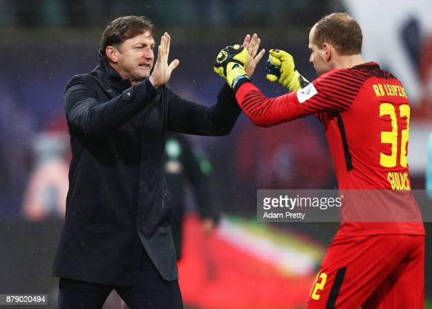 Ralph Hasenhuettl head coach of RB Leipzig celebrates the second goal with Peter Gulacsi of RB Leipzig during the Bundesliga match between RB Leipzig...