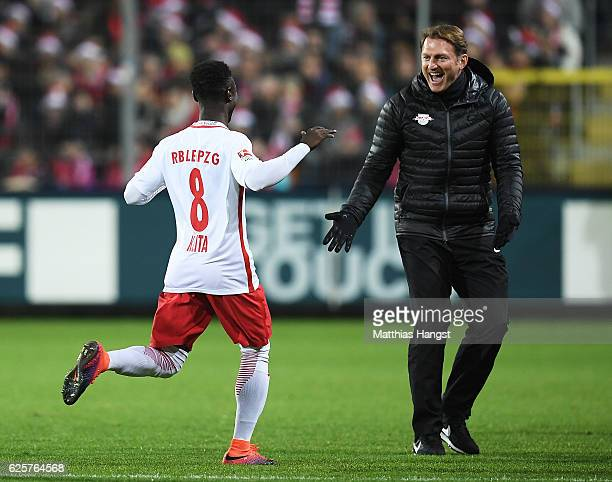Ralph Hasenhuettl head coach of RB Leipzig congratulates Naby Deco Keita of RB Leipzig after he scored the first goal during the Bundesliga match...