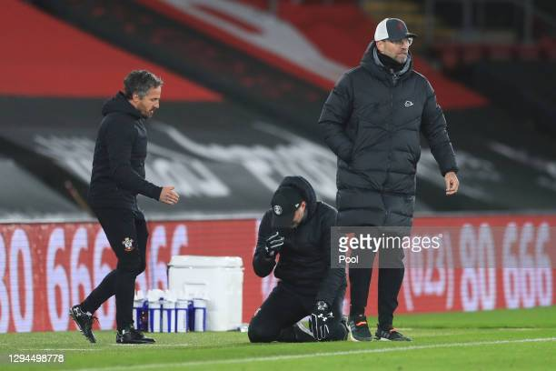Ralph Hasenhuttl, Manager of Southampton celebrates victory with his assistant manager Richard Kitzbichler as Jurgen Klopp, Manager of Liverpool...