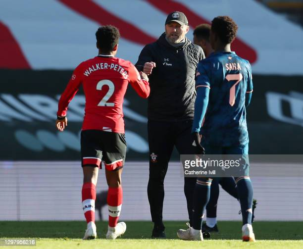 Ralph Hasenhuttl, Manager of Southampton celebrates with Kyle Walker-Peters of Southampton following their side's victory after The Emirates FA Cup...
