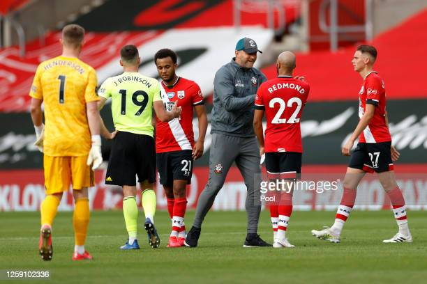 Ralph Hasenhuttl Manager of Southampton congratulates Nathan Redmond after the Premier League match between Southampton FC and Sheffield United at St...