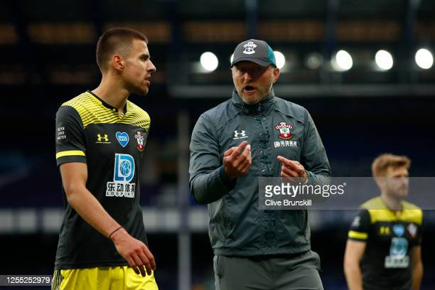 Ralph Hasenhuttl Manager of Southampton speaks to Jan Bednarek of Southampton after the Premier League match between Everton FC and Southampton FC at...