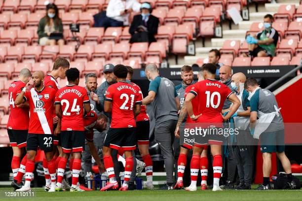 Ralph Hasenhuttl Manager of Southampton talks with his players during drinks break during the Premier League match between Southampton FC and...