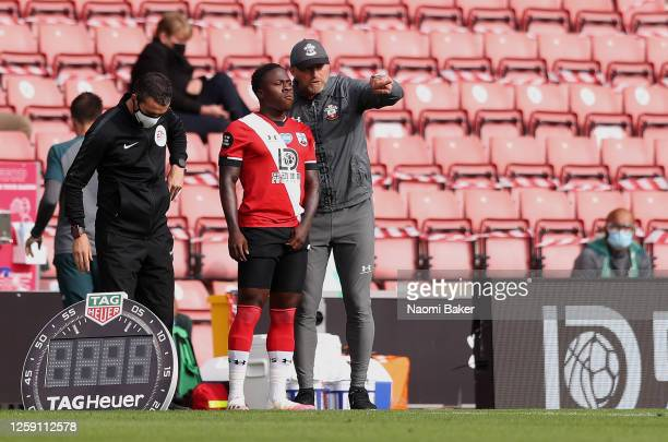 Ralph Hasenhuttle Manager of Southampton talks to Michael Obafemi of Southampton during the Premier League match between Southampton FC and Sheffield...