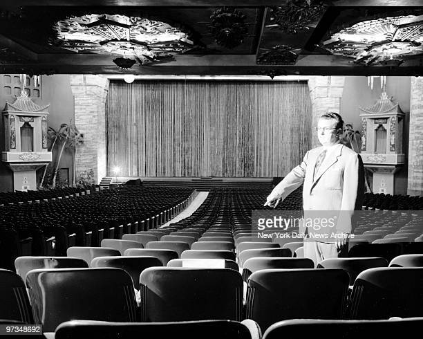 Ralph Hathaway manager of Grauman's Chinese Theater points to seat in Row 35 where Maureen O'Hara is alleged to have cuddled with a Latin lover...