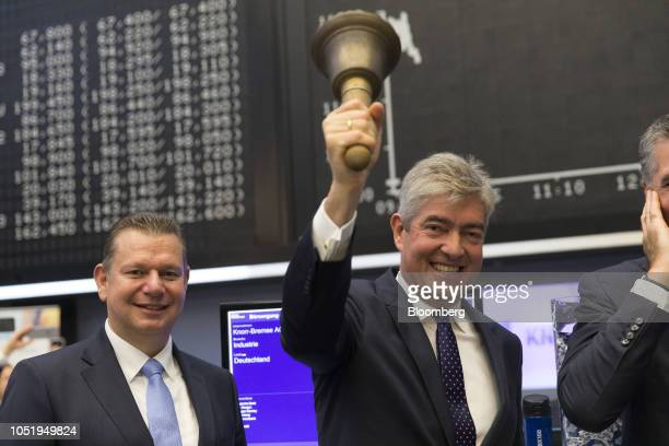 Ralph Heuwing chief financial officer of KnorrBremse AG rings the trading bell beside Peter Laier member of the management board at KnorrBremse AG as...