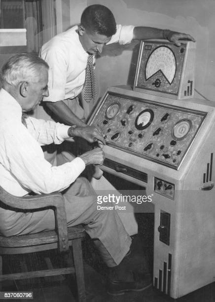 Ralph L Horst chief of the regional food office in Denver and his chief chemist Sam D Fine a machine seized by FDA during 1956 ***** Credit Denver...
