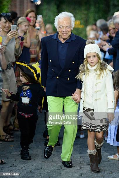 Ralph Lauren and models walk at Ralph Lauren Children's Fashion Show at Central Park Zoo on August 5 2015 in New York City