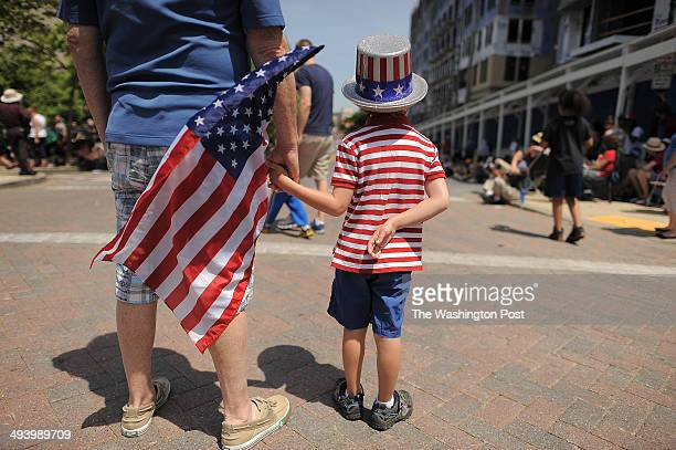 Ralph Lieberthal of Gaithersburg MD left stands with his grandson Cole Lieberthal of Annandale VA center as they watich a Memorial Day parade that is...