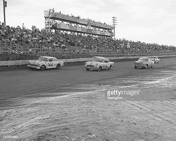 Ralph Ligouri's Chevrolet leads the Buick of Bill Morton and the Hudson of Joe Guide during the NASCAR Cup race at MemphisArkansas Speedway
