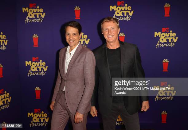 Ralph Macchio and William Zabka pose backstage during the 2021 MTV Movie & TV Awards at the Hollywood Palladium on May 16, 2021 in Los Angeles,...