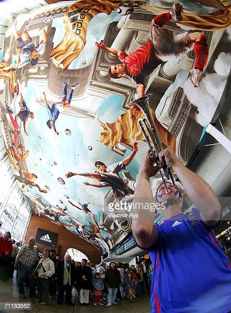 Ralph 'Mosch' Himmler plays trumpet during the presentation of a huge 800 square meter World Cup Themed adidas poster at the entrance hall of the...