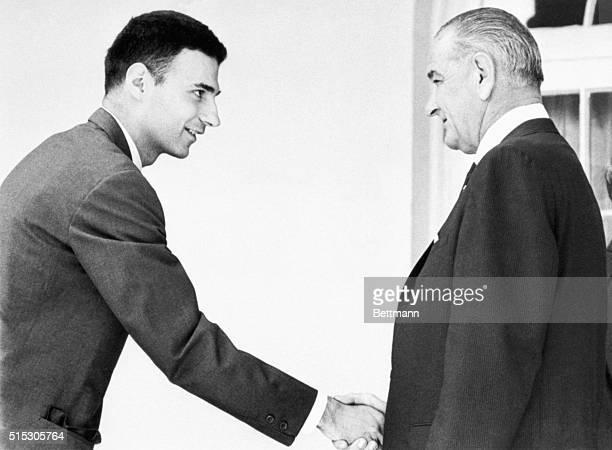 Ralph Nader and President Lyndon B Johnson shake hands at the White House following the signing of new automobile and highway safety acts