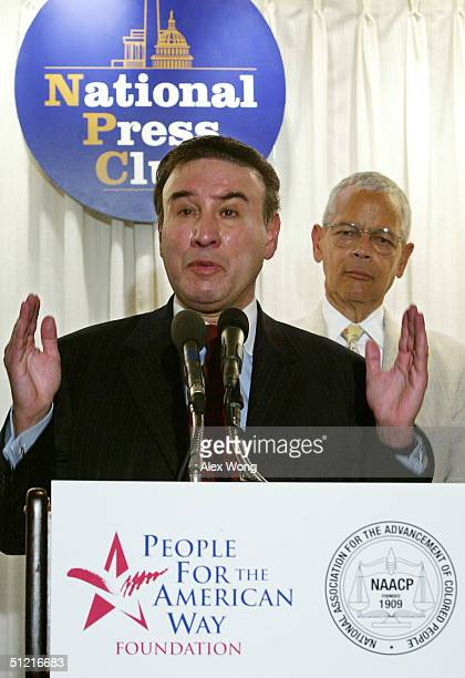 Ralph Neas , President of People for the American Way Foundation , speaks as NAACP Chairman Julian Bond looks on during a news conference at the...