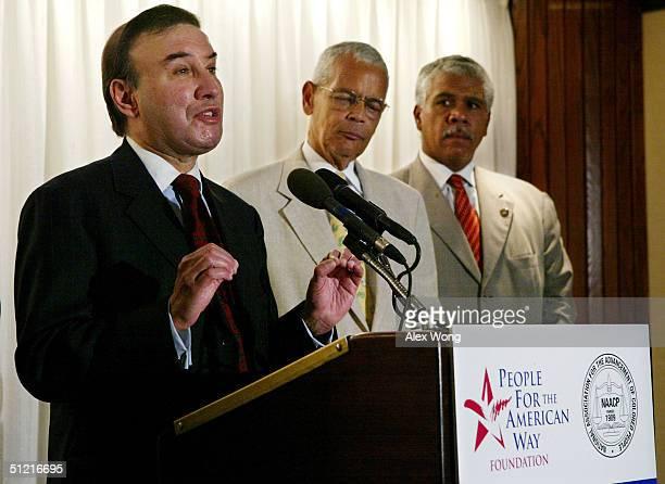 Ralph Neas, President of People for the American Way Foundation , speaks as NAACP Chairman Julian Bond and NAACP Washington Bureau Director Hillary...