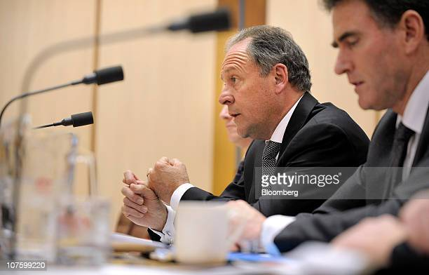 Ralph Norris chief executive officer of Commonwealth Bank of Australia second right speaks before the public hearing of a Senate Economics Committee...