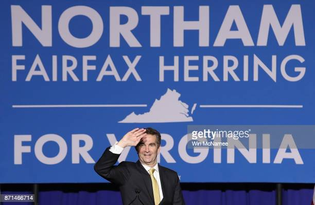 Ralph Northam the Democratic candidate for governor of Virginia greets supporters during an election night rally November 7 2017 in Fairfax Virginia...