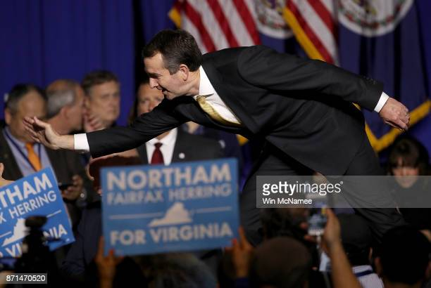 Ralph Northam the Democratic candidate for governor of Virginia greets supporters at an election night rally November 7 2017 in Fairfax Virginia...