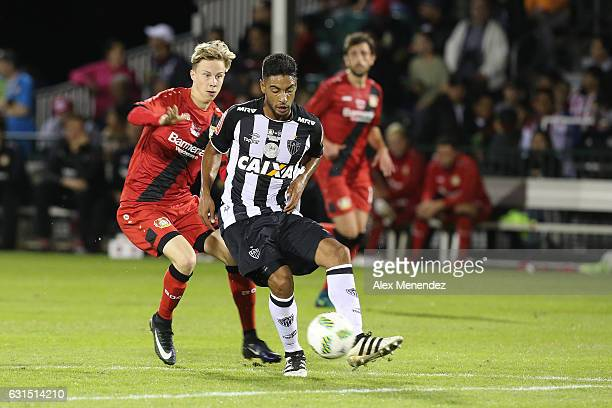 Ralph of Atletico Mineiro dribbles the ball against Schreck of Bayer Leverkusen at ESPN Wide World of Sports Complex on January 11 2017 in Kissimmee...