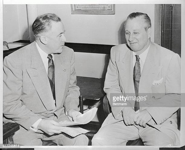 Ralph Pierce former Capone mobster talks with police Lt James McMahon after he surrendered to authorities Pierce who appeared voluntarily denied any...