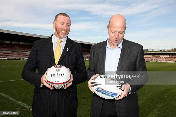 Ralph Rimmer Rugby Football League Chief Operating Officer and David Cardoza chairman of Northampton Town FC pose during a photo call to announce...
