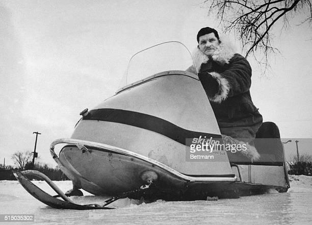 Ralph S Plaisted a St Paul Minnesota insurance agency owner tries out a snowmobile of the type he will use when he leads a 10 man machine expedition...