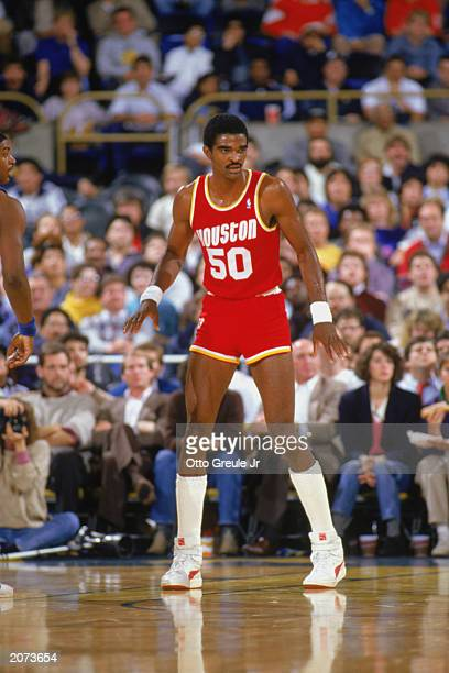 Ralph Sampson of the Houston Rockets looks on during a game in the198788 season NOTE TO USER User expressly acknowledges and agrees that by...