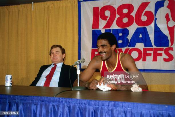 Ralph Sampson of the Houston Rockets talks with the media along with Bill Fitch of the Houston Rockets during the 1986 NBA Playoffs during a game...