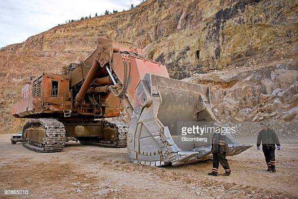 Ralph Saunders a shovel mechanic left and Justin Mortimeyer perform a safety inspection on a Hitachi excavator at the AngloGold Ashanti Ltd Cripple...