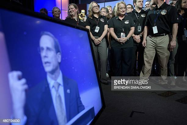 Ralph Semmel director of the Johns Hopkins University Applied Physics Laboratory speaks as members of the New Horizons mission team listen to a press...