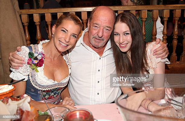 Ralph Siegel and his daughter Giulia and daughter Alana during Oktoberfest at Kaeferzelt/Theresienwiese on October 2 2014 in Munich Germany