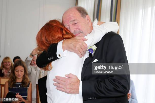 Ralph Siegel embraces Laura Kaefer during their civil wedding at the registry office Gruenwald on September 14 2018 in Munich Germany