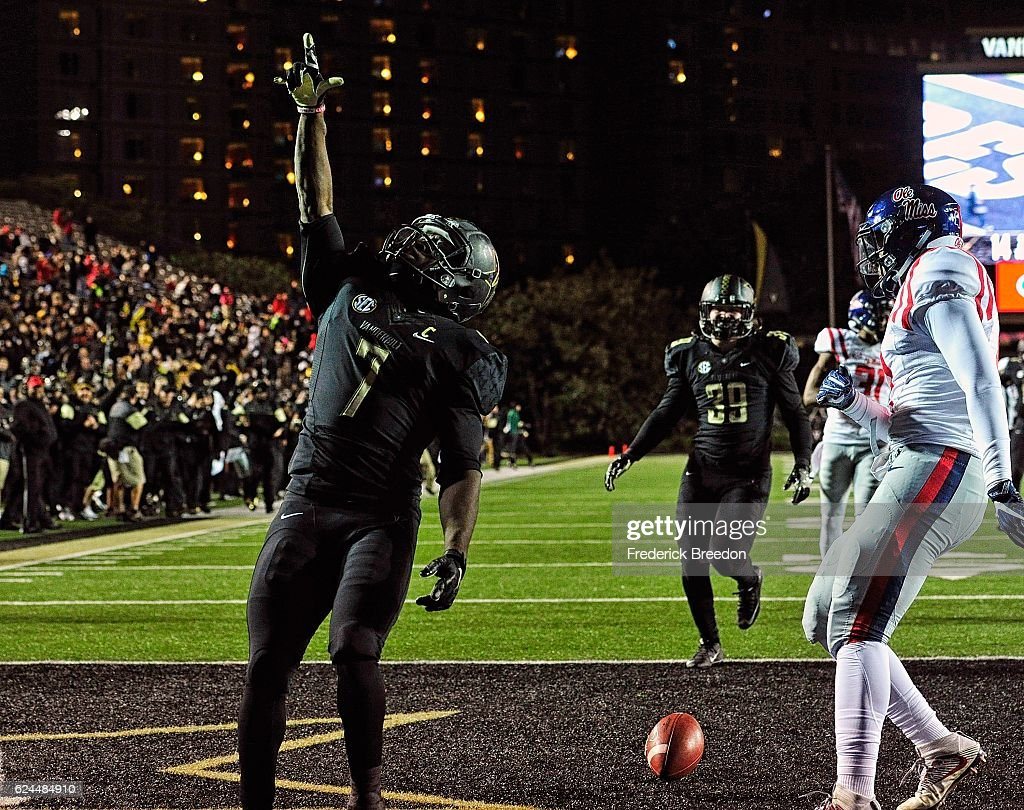 Ralph Webb #7 of the Vanderbilt Commodores celebrates after scoring a touchdown against the Ole Miss Rebels during the second half at Vanderbilt Stadium on November 19, 2016 in Nashville, Tennessee.