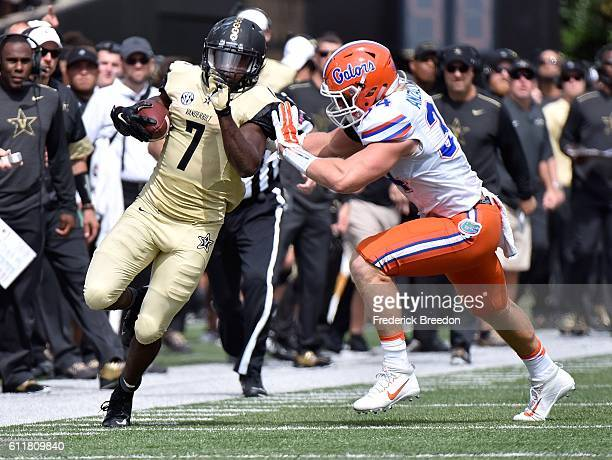 Ralph Webb of the Vanderbilt Commodores is pushed out of bounds by Alex Anzalone of the Florida Gators during the first half at Vanderbilt Stadium on...