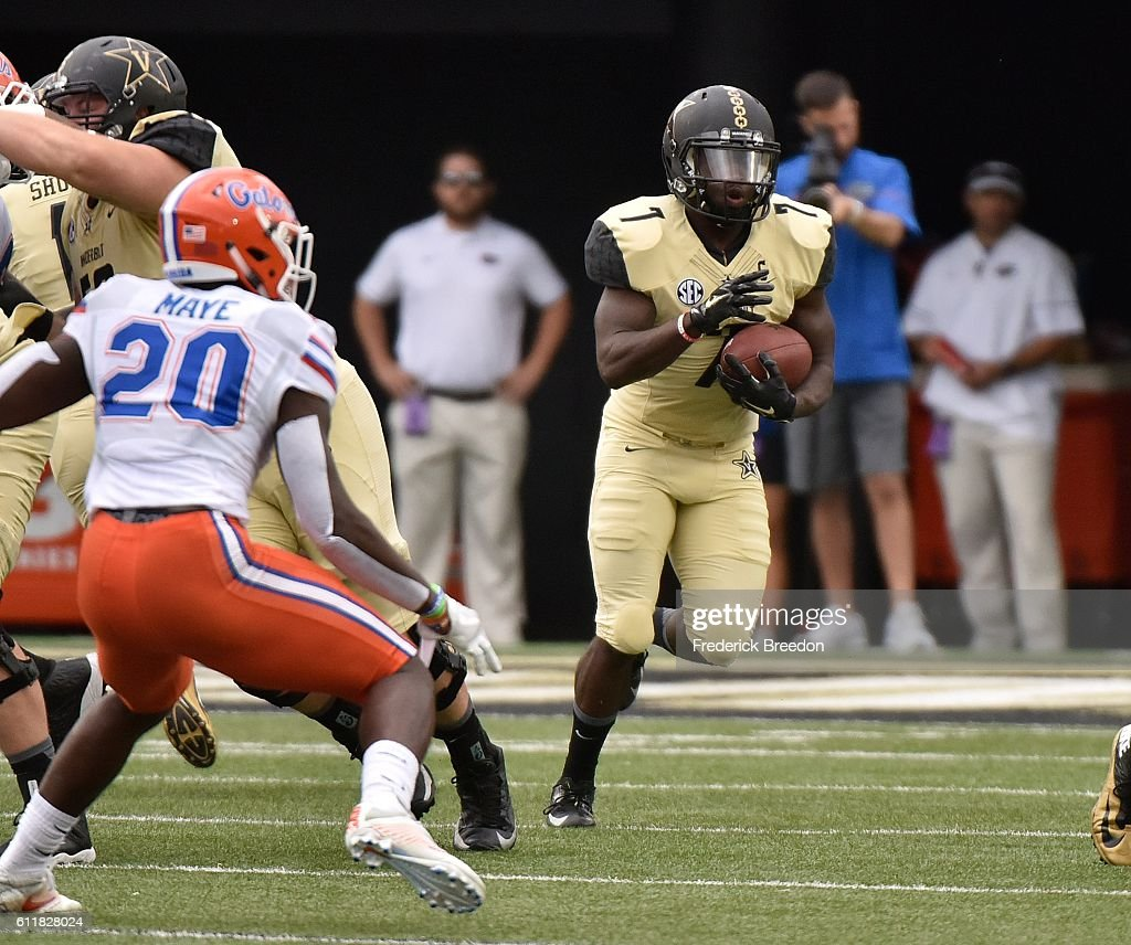 Ralph Webb #7 of the Vanderbilt Commodores rushes against Marcus Maye #20 of the Florida Gators during the first half at Vanderbilt Stadium on October 1, 2016 in Nashville, Tennessee.