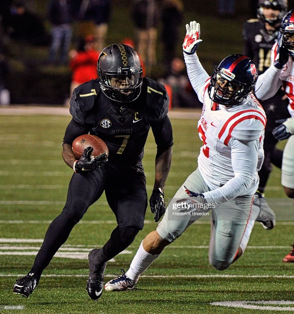 Ralph Webb #7 of the Vanderbilt Commodores rushes against the Ole Miss Rebels during the second half at Vanderbilt Stadium on November 19, 2016 in Nashville, Tennessee.