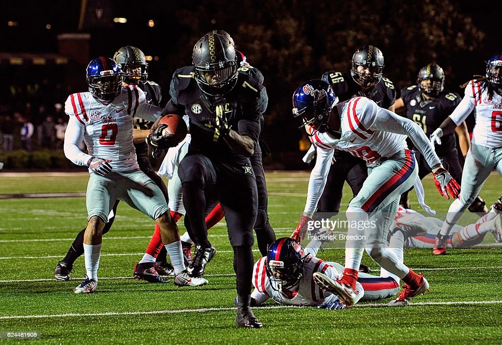 Ralph Webb #7 of the Vanderbilt Commodores scores a touchdown against the Ole Miss Rebels during the second half at Vanderbilt Stadium on November 19, 2016 in Nashville, Tennessee.
