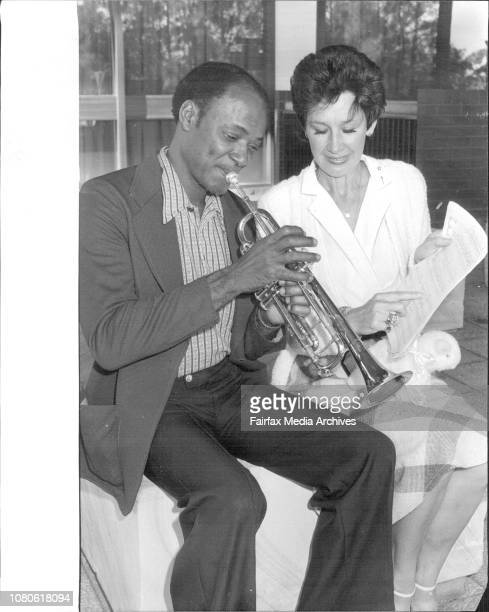 Ralph Williams leader of the US Army's 25th Infantry Division's Band pictures with Adrienne Lamb composer of 'Herman Nelson March' and Corporal *****...