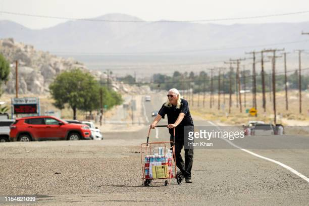Ralph Zeb Haleman carries cases of water home July 7 2019 Residents of Trona were still without water after the 71 earthquake on July 5
