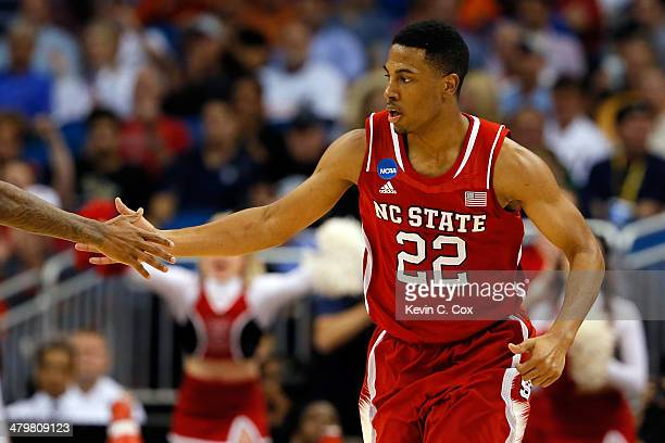 Ralston Turner of the North Carolina State Wolfpack celebrates a shot against the Saint Louis Billikens during the second round of the 2014 NCAA...