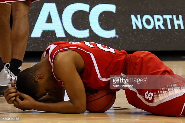 Ralston Turner of the North Carolina State Wolfpack reacts over the ball against the Saint Louis Billikens during the second round of the 2014 NCAA...