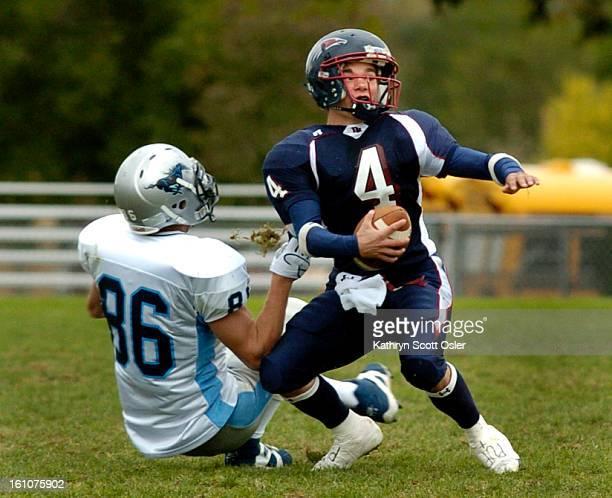 Ralston Valley vs. Dakota Ridge football at Jeffco Stadium. Dakota QB Eric Cain's helmut is pulled sideways in the 4th quarter and Ralston Valley's...