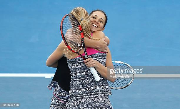 Raluca Olaru of Romania and Olga Savchuk of Ukraine celebrate winning match point in their Women's Doubles Final match against Gabriela Dabrowski of...