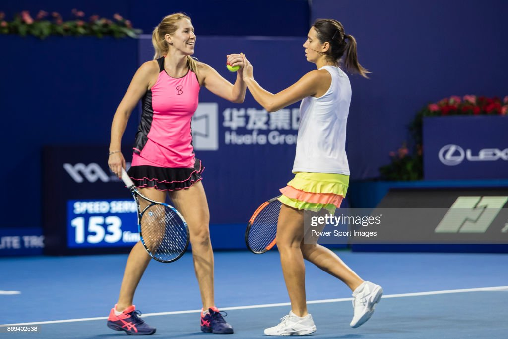 Raluca Olaru of Romania (R) and Olga Savchuk of Ukraine (L) celebrate winning a point during the doubles Round Robin match of the WTA Elite Trophy Zhuhai 2017 against Ying-Ying Duan and Xinyun Han of China at Hengqin Tennis Center on November 02, 2017 in Zhuhai, China.