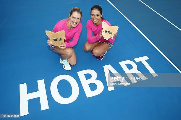 Raluca Olaru of Romania and Olga Savchuk of Ukraine pose with the winners trophies after winning their doubles final match against Gabriela Dabrowski...