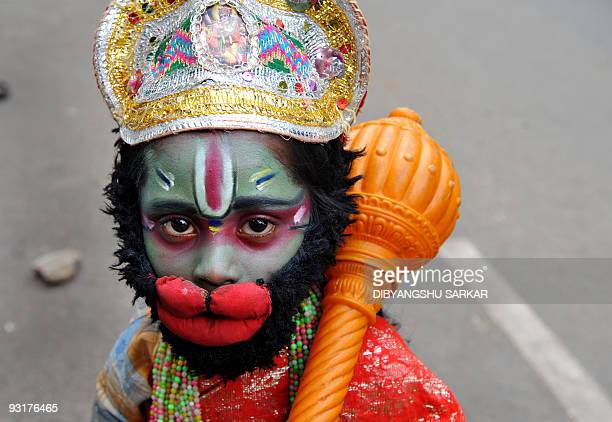 Ram Babu dressed as Hindu ape god Hanuman begs on the side of a busy road in Bangalore on November 18 2009 Babu dresses like different Hindu gods for...