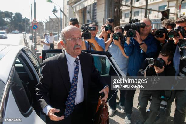 Ram Caspi, the prime minister's lawyer, arrives at the Ministry of Justice in Jerusalem on October 2, 2019 ahead of the pre-indictment hearing for...