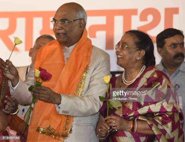 Ram Nath Kovind with his wife Savita Kovind received great flower after his win in Presidential election at 10 Akbar Road on July 20 2017 in New...