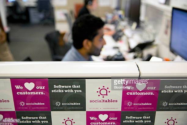 Ram Parimi vice president of sale and account management at Social Tables Inc works behind a wall of magnets at the Social Tables headquarters in...