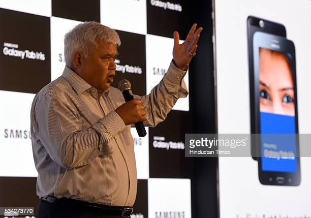 Ram Sewak Sharma Chairperson of the Telecom Regulatory Authority of India addresses media person during the launch of Galaxy Tab Iris featuring...